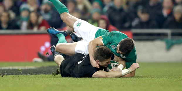 Beauden Barrett is in no doubt he grounded the ball in a controversial try during the All Blacks victory over Ireland this morning. Photo / Getty