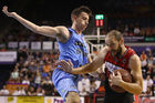 David Stockton of the Breakers defends as Rhys Martin of the Hawks drives to the basket. Photo / Getty