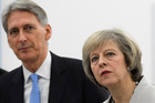 British Prime Minister Theresa May and chancellor of the exchequer Philip Hammond. Photo / Getty