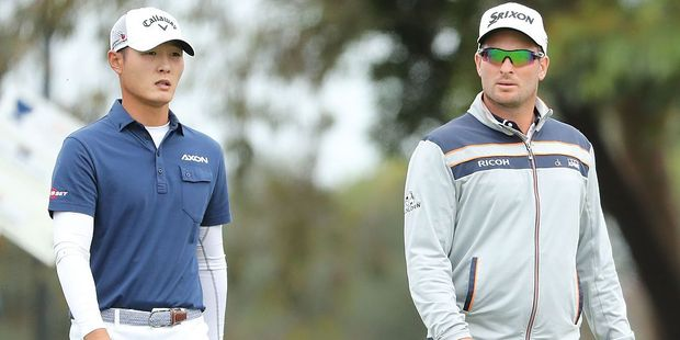 Danny Lee and Ryan Fox of New Zealand look on during day two of the World Cup of Golf. Photo / Getty