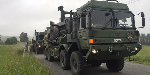 The NZDF's new medium and heavy operation vehicles - powerful, high-tech eight-wheeled machines steered by skilled combat drivers, are more than a match for the damaged roads. Photo / Kurt Bayer