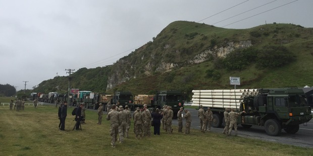 The convoy stops. We wait. The message is relayed: the road needs to be checked.  Photo / Kurt Bayer