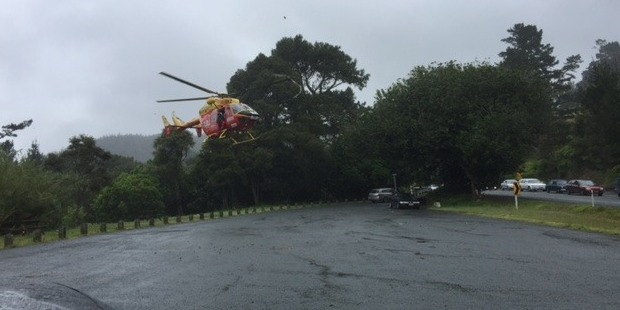 The Westpac Rescue Helicopter leaves the scene. Photo / Bill Caltrop