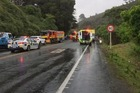 The crash scene at Dome Valley where a critically injured woman was taken by helicopter to Auckland City Hospital. Photo / Bill Caltrop