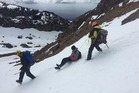 Rescuers help a walker who was in difficulty on a steep ski slope at Whakapapa on Mt Ruapehu. Photo / Ruapehu Alpine Rescue Organisation