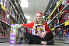 McKenzie Craig from The Warehouse, with a couple of popular toys for Christmas. Photo/John Borren
