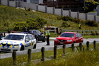 Police at the scene on Redoubt Rd in Flat Bush, South Auckland, after a person was killed when a car crashed into a house. Photo / Dean Purcell