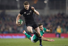 All Blacks first-five Beauden Barrett on his way to score during the test match between the New Zealand All Blacks and Ireland. Photo / Brett Phibbs