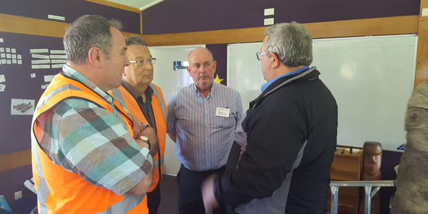Acting Civil Defence Minster Gerry Brownlee, right, makes a visit to Kaikoura High School to help assess earthquake damage following the earthquakes. Photo / Supplied