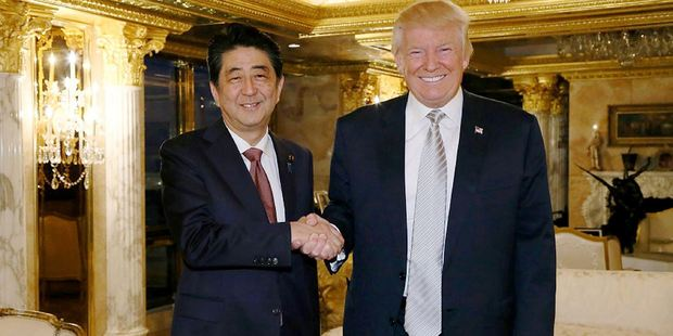 Japan's Prime Minister Shinzo Abe, left, shakes hands with President-elect Donald Trump in New York City. Photo / AP