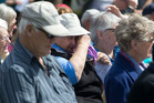 Some, including the mayor, showed their emotions at the open-air church service in Kaikoura today. Photo / Alan Gibson
