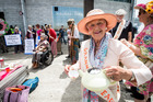 Mary Woodward makes tea not war at the Grannies for Peace protest on Queen's Wharf. Photo / Jason Oxenham