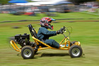 Oliver Cartwright, 7, puts his foot down at the Omokoroa No1 School Mower Races and Gala day. PHOTO/GEORGE NOVAK