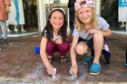 Meila Stewart ,8 (left), and Neve Fitzgerald, 9, add the finishing touches to their chalk drawing. Photo/Sonya Bateson
