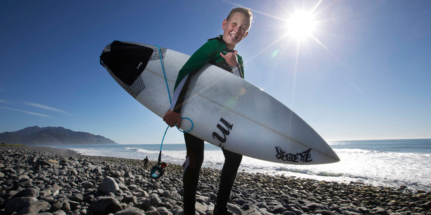 "Reuben Lyons, 12, at  Meatworks. He said the world-famous surf break was ""pumping"" today. Photo / Alan Gibson"