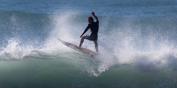 Loading A surfer enjoying the perfect conditions today at a famous Kaikoura surf break Meatworks. Photo / Alan Gibson