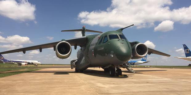 The KC-390 with new commercial planes in the background. Photo / Grant Bradley
