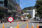 Scaffolding being erected on the exterior of the GCSB and SIS building in Wellington due to damage from the November 14 Kaikoura earthquake. Photo / Mark MItchell