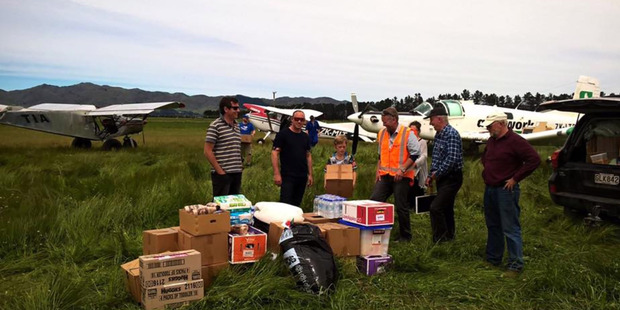 Pilots of the NZ Farming and Andrea's Army who delivered supplies to tiny Rakautara, 22km north of Kaikoura, today for the first time since last Monday's earthquake. Photo / Supplied