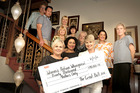 The organisers of the Great Ball to benefit Whanganui Women's Refuge, and three women who sang its theme song, pose with a cheque for the money raised. PHOTO/ BEVAN CONLEY