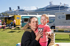 CRUISING: Kate McDermott and Ayla, 17 months, enjoying the Picnic in the Park event to celebrate the first overnight cruise ship visit to the Bay. PHOTO/GEORGE NOVAK