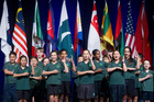 WELCOME: Lynmore School pupils perform for the foreign delegates after carrying the flags on to the stage at the welcome function. PHOTO/STEPHEN PARKER