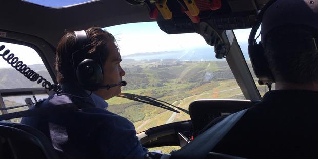 Transport minister Simon Bridges on an aerial tour of earthquake-affected highway 1 near Kaikoura. Photo / Kurt Bayer