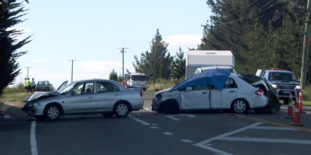 Loading Scene of a four car accident on State Highway 1 near Moeraki that left one person dead. picture / Southern Stringers