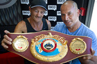 Mike Sykes, left, and Temuera Morrison with the belt in Rotorua. PHOTO/STEPHEN PARKER