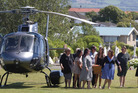 The coffin of Jo-Anne Mackinnon is carried from a helicopter to be buried in a cemetery at Kaikoura this morning. Photo / Alan Gibson