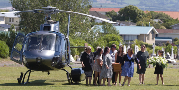 Loading The coffin of Jo-Anne Mackinnon is carried from a helicopter to be buried in a cemetery at Kaikoura this morning. Photo / Alan Gibson