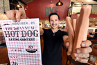 Jay Kolenski, Rye American Kitchen manager, gets ready for Saturday's hot dog eating competition to raise money for men's health. Photo/George Novak