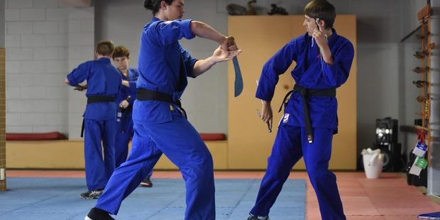 Loading Mile High Karate Club students Luke Hardy, left, and Chase Marshall. Photo: George Novak
