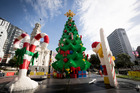 Ryan McNaught with the Lego Christmas tree in Aotea Square. His team added a  rugby ball, kiwi, pukeko (below) and a sacred kingfisher to give it a more local look. Photo / Dean Purcell