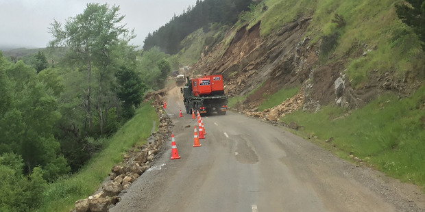 Loading The New Zealand Army convoy makes its way through earthquake ravaged countryside on the inland road to Kaikoura. Photo / Kurt Bayer