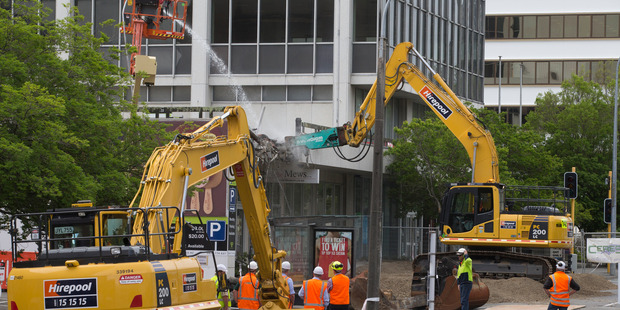 Loading Demolition work underway on the shopping annex attached to the nine-storey building at 61 Molesworth Street in Wellington. Photo / Mark Mitchell