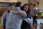 Prime Minister John Key gets a hug from Helen Beattie in Waiau.  Photo / Pool