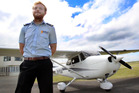 Flight instructor Sebastian Chatterley with the Cessna 172 plane at Wanganui Aero Club.