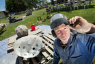 CREATIVITY: Rotorua's Jamie Pickernell braved the heat as he worked on his sculpture yesterday. PHOTO/BEN FRASER