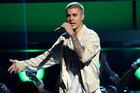 Justin Bieber punched someone in the face from his moving vehicle. Photo / AP