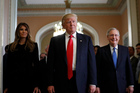 President-elect Donald Trump and his wife Melania walk with Senate Majority Leader Mitch McConnell. Photo / AP