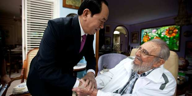 Cuba's former leader Fidel Castro, right, shakeing hands with Vietnamese President Tran Dai Quang, left, in Havana, Cuba on November 15, 2016. Photo / AP