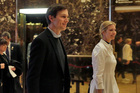 Jared Kushner and his wife Ivanka Trump walk through the lobby of Trump Tower in New York. Photo / AP