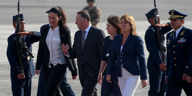 John Key and his wife Bronagh, fourth from left, walk the guard of honor upon their arrival to Lima. Photo / AP