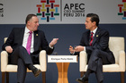 PM John Key talks to Mexican President Enrique Pena Nieto yesterday during a forum about trade at  the APEC CEO Summit in Lima, Peru. Photo / AP