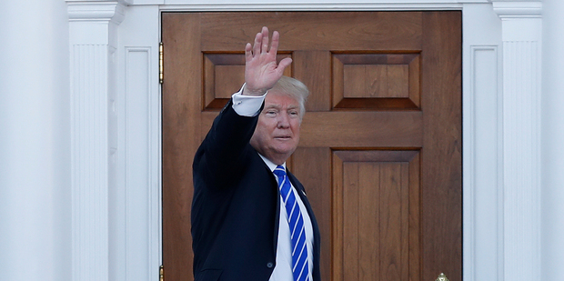 President-elect Donald Trump waves before turning to enter Trump National Golf Club Bedminster clubhouse. Photo / AP