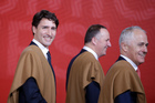 Canada's Prime Minister Justin Trudeau, left, Prime Minister John Key, center and Australia's Prime Minister Malcolm Turnbull leave after a group photo. Photo / AP