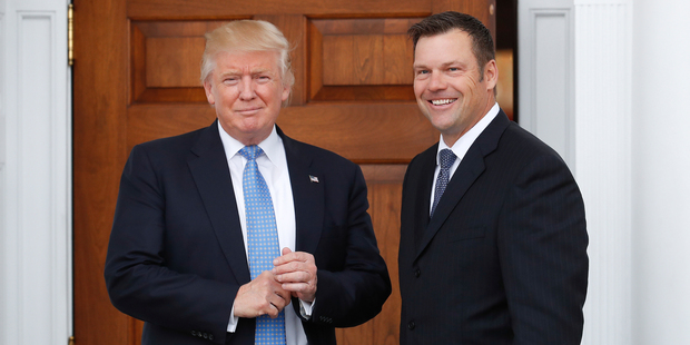 Loading President-elect Donald Trump poses for photographs with Kansas Secretary of State, Kris Kobach, at the Trump National Golf Club in Bedminster. Photo / AP
