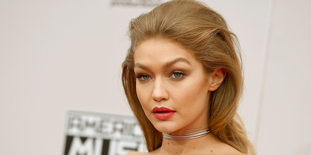 Gigi Hadid, courted crotch danger in a different way, donning a white off-the-shoulder Cavalli dress that required some deft under-panting. Photo / AP