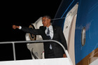 Barack Obama gives one final wave as he prepares to fly home from Lima yesterday. Photo / AP